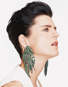 Stella Tennant models Joel Arthur Rosenthal's handmade pieces. Weeping-willow pendant earrings of chrysoberyls and diamonds.
