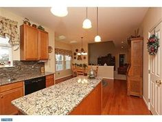 Spacious kitchen with granite counter tops.