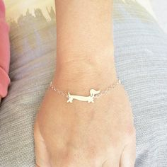 Yet another must have piece featuring my favourite thing in the world - Dachshunds, Yay! This piece is perfectly dainty & quirky! -d e s c r i p t i o n- 100% handmade from sterling silver The Dachshund bracelet is gently curved, measuring approx. 2.7cm wide. ! It is finished in a