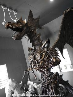 Steampunk dragon made out of recycled metal and auto parts