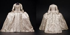 1760-1765 The mantua was the signature style of dress for ladies attending court. It is made from white silk satin brocaded with a pattern of stripes and scrolling garlands of exotic flowers in silver thread and trimmed with si