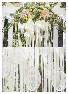 Lace or doilies inside of embroidery hoops and hung with ribbon. Genius!