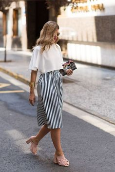 Street style   Chic white top, striped skirt, pink shoes, bracelet, clutch