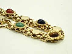 Vintage costume jewelry gold bracelet with cabochons. $15.00, via Etsy.