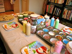 Hosting a Christmas party this weekend how about doing this great cookie decorating station for the kids!