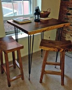 Custom High Bar Dining Table.  Monkeypod wood top, steel hairpin legs by Impact Imports.  Bar stools are acacia wood.