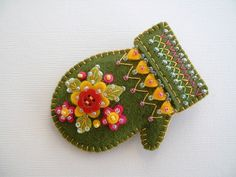 Beaded felt mitten pin - green--these are adorable! Something different than just doing ornaments too! Christmas Ornaments To Make, Felt Ornaments, Handmade Christmas, Christmas Crafts, Homemade Ornaments, Christmas Tree, Christmas Colors, Felt Embroidery, Felt Applique
