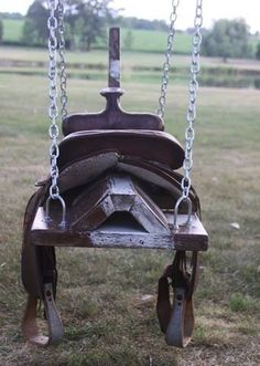 saddle horse swing- would be cute with horse head, mane, and tail! just remove saddle when not in use. Wish I'd kept my saddle! Saddle Swing, Kids Saddle, Saddle Rack, Tire Horse Swing, Saddle Chair, Chair Swing, Boot Rack, Swinging Chair, Swing Design