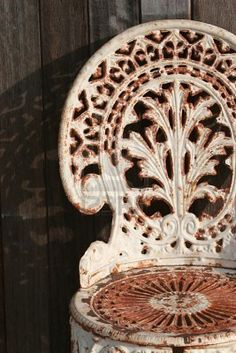 rusty wrought iron chair