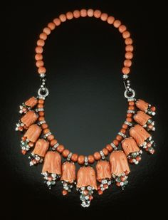 Cartier designed this carved coral bellflower drop and bead necklace circa 1950. It's a kinetic piece – the flowers and the stamens wave in the wind. It's also somewhat unique: No natural opaque gemstone has the soft orange colors of coral. Photo © GIA and Tino Hammid.