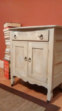 """Yucky old cabinet I purchased for $45 at a thrift store. I used Waverly Inspirations Chalk Paint in """"Mineral"""" and """"Plaster"""", """"Antique Wax"""" was applied for the aged look of the piece."""