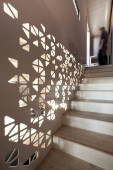 Perforated sheet metal creates wall for staircase. Love! ||  claudio bonicco