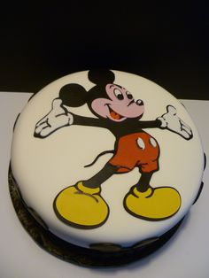 "Mickey Mouse Cake - 10"" double layer chocolate cake made for the children's birthday celebration at a residential recovery center - as a member of Birthday Cakes 4 Free - MN. It was filled and iced with chocolate ganache and chocolate buttercream and covered with MFF. The graphics were cut from MFF/gumpaste using my Cricut Cake. Thanks for looking!"