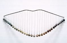 Mari Andrews. Wire and stone sculptures, organic art.