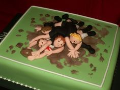 Rugby pile of players cake