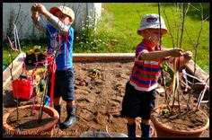A Reggio inspired art actvity outside using branches and ribbon