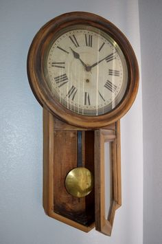 """Mary Matuskey: """"1906 Oak pendulum clock with original crank key. From Michigan grade school, when the school was remodeled my aunt received this clock. I inherited it where now it hangs in my Arizona hous"""
