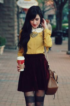 mustard shirt with adorable collar and maroon velvet skirt. Lovely hair and makeup too.
