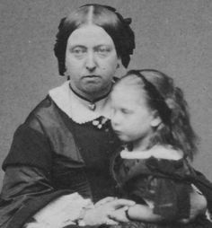 Queen VIctoria with Princess Beatrice.  Victoria looks deeply depressed in the photo made shortly after the death of Prince Albert.