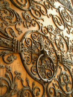 Vintage wrought iron on door. Love.