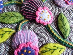 Embroidered and appliqued flowers quilted onto front piece, batting and backing. Description from pinterest.com. I searched for this on bing.com/images