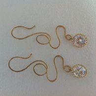 Cool earrings! Handmade brass findings, crystal stones.