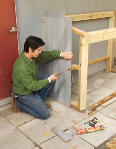 Create an outdoor waste and recycling shed with flip-open lids and easy-access bifold doors