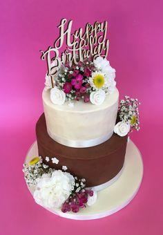 Chocolate and vanilla buttercream cake with fresh flowers