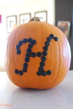 Black thumb tacks and a pumpkin. Love the monogram!!