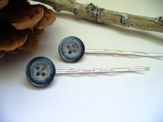 Check out this item in my Etsy shop https://www.etsy.com/listing/35689607/vintage-buttons-blue-bobby-pins-back-to