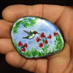 Painted Rock - Tiny H-bird and flowers. #elymn #wilderness #wildernessculture #bwca #intothbrush #hummingbird #rockpainting #paintedrocks #handmadegifts #handpainted