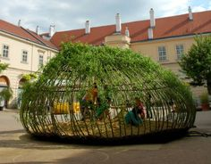 Kagome Sandpit – A naturally 'growing' kid's sandpit, the outdoor playing area of the Vienna Museums  Quartier. the 'structure' is defined by willow strips enclosing the interior volumetric space.