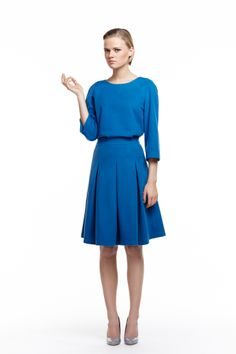 LOOK III #5 Peacock blue wool and cashmere-blend top; A-line shape, flared, raglan sleeves, zip fastening. #6 Peacock blue wool and cashmere-blend skirt; high-waist, fitted waistband, zip fastening, pleated, fully lined. byplakinger.com