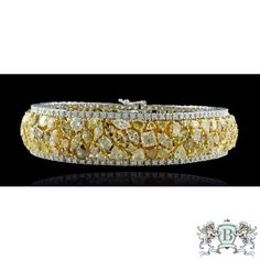 20.23 CARAT FANCY YELLOWISH ORANGE OVAL DIAMOND BRACELET