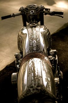 Tooled chrome motorcycle---amazing, but my ass sure would hurt bare backing that fender!
