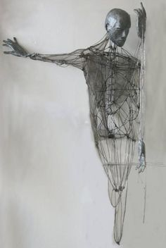 3-D mixed media  Draw a figure in a sketchy architectural way. Emphasis on lines and movement