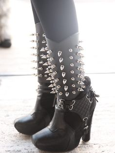 Talk about rocker-chic! We love her Balenciaga shoes and spiked shinguards.
