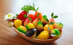 Look Choup a famous Thai dessert that has colorful and nice visual, they make to fruit-shaped and coated with thin layer of jelly.