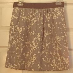 LOFT Silver & Cream Floral Skirt Silver and cream floral skirt from LOFT! Really cute, in perfect condition. Has pockets and a cute zipper on the back! Length is 18 inches. LOFT Skirts