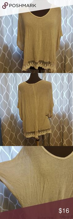 Lace trim top Queen Ester cream lose fitting top. Fits almost like a poncho.  Has lace trim bottom and slight vneck. Size small, but could fit up to a large because of the style. Tops Blouses