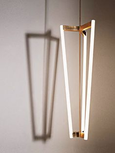 Tube Chandelier | Michael Anastassiades | Simple lines, elegant details; perfect for tall spaces and en masse.