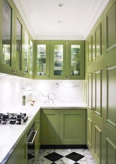 Small galley style kitchen by Greg Natale.