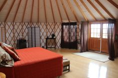 The Lattice Look - A common interior feature of yurts are the lattice walls which are a major component of the support structure. This bedroom model from Yurts of America uses 99 percent knot-free poplar wood for the lattice walls which allow for a heavier stress load and a longer life.