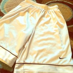 White NIKE basketball shorts White shorts with black detailing. Great for relaxing in. Nike Shorts