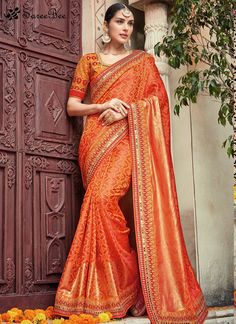 This eye catching elegant drape is perfect for any occasion. Outstanding craftmanship of embellishments exhibited in this orange georgette traditional saree. The brilliant attire creates a dramatic c...