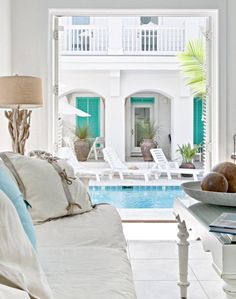 Carillon Beach House Decor ~ light airy feel...and check out the driftwood floor lamp!