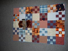 Annapolis Quilt Guild dresses bears and makes quilts for the Salvation Army to gift to children at Christmas.  This quilt was made from men's shirts.
