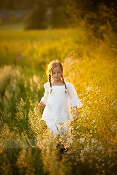 Wandering in the fields of gold. -- this looks like me as a child, pigtails and all. My greatest love was wandering through the fields, picking berries and wildflowers...