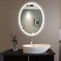 Pic Of An elegant oval mirror gives the linear bathroom a hint of curves Satin nickel