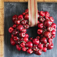 This easy harvest-time stunner is formed from simple materials: a burlap-wrapped wreath form, faux craft apples, a neutral mossy filler, and plenty of hot glue. The best part about crafting with fake apples? You'll have a stunning wreath that lasts multiple seasons with no juicy problems later!/